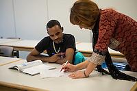 Sprachunterricht fuer Fluechtlinge bei der Handwerkskammer in Cottbus.<br /> In Zusammenarbeit mit dem regionalen Jobcenter, Fluechtlingshilfen und zustaendigen Behoerden versucht die Handwerkskammer Fluechtlingen eine Perspektive fuer Fluechtlinge zu schaffen. Zwischen bis zu 20 Fluechtlinge aus Eritrea, Afgahnistan, Syrien und Pakistan lernen hier Deutsch und bekommen die Moeglichkeit sich ueber die ausserbetrieblichen Ausbildungsmoeglichkeiten zu informieren oder bei Firmenbesuchen einen Ausbildungsplatz suchen.<br /> Entstanden ist diese Initiative der Handwerkskammer Cottbus aufgrund der geringen Zahl an Auszubildenden. Zu viele junge Menschen verlassen die Region. Dies bereitet den Handwerksbetrieben grosse Probleme.<br /> Im Bild: Karin Lucowitsch, Deutsch-Magister (rechts), beim Unterricht mit dem Fluechtling Aynalem aus Eritrea.<br /> 11.11.2015, Cottbus<br /> Copyright: Christian-Ditsch.de<br /> [Inhaltsveraendernde Manipulation des Fotos nur nach ausdruecklicher Genehmigung des Fotografen. Vereinbarungen ueber Abtretung von Persoenlichkeitsrechten/Model Release der abgebildeten Person/Personen liegen nicht vor. NO MODEL RELEASE! Nur fuer Redaktionelle Zwecke. Don't publish without copyright Christian-Ditsch.de, Veroeffentlichung nur mit Fotografennennung, sowie gegen Honorar, MwSt. und Beleg. Konto: I N G - D i B a, IBAN DE58500105175400192269, BIC INGDDEFFPakistan, Kontakt: post@christian-ditsch.de<br /> Bei der Bearbeitung der Dateiinformationen darf die Urheberkennzeichnung in den EXIF- und  IPTC-Daten nicht entfernt werden, diese sind in digitalen Medien nach §95c UrhG rechtlich geschuetzt. Der Urhebervermerk wird gemaess §13 UrhG verlangt.]