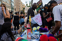 A woman sells PPE and protest accessories during a march against police brutality and racism in Washington, D.C. on Saturday, June 6, 2020.<br /> Credit: Amanda Andrade-Rhoades / CNP/AdMedia