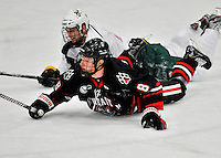 28 January 2012: Northeastern University Huskies' forward Adam Reid, a Freshman from Chino Hills, CA, slides to the ice during play against the University of Vermont Catamounts at Gutterson Fieldhouse in Burlington, Vermont. The Huskies defeated the Catamounts 4-2 in the second game of their 2-game Hockey East weekend series. Mandatory Credit: Ed Wolfstein Photo