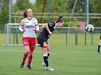 Anke Vanhooren (7) of Eendracht Aalst heads the ball away before Ella Vierendeels (4) of Zulte-Waregem can get to it during a female soccer game between SV Zulte - Waregem and Eendracht Aalst on the 9 th matchday in play off 2 of the 2020 - 2021 season of Belgian Scooore Womens Super League , saturday 22 nd of May 2021  in Zulte , Belgium . PHOTO SPORTPIX.BE   SPP   DIRK VUYLSTEKE