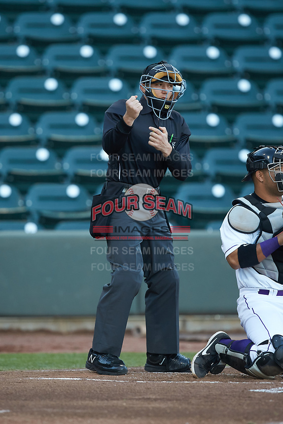 Home plate umpire Steven Hodgins makes a strike call during the Carolina League game between the Wilmington Blue Rocks and the Winston-Salem Dash at BB&T Ballpark on April 16, 2019 in Winston-Salem, North Carolina. The Blue Rocks defeated the Dash 4-3. (Brian Westerholt/Four Seam Images)