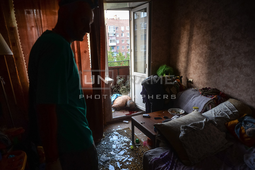 Doctor examines scene in a flat where a man was killed by shelling in Donetsk, Eastern Ukraine. At least 2 people were killed and many were injured after several shells hit a central neighborhood. Donetsk, Ukraine, Sept. 04, 2014.