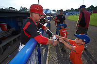 Batavia Muckdogs outfielder Kyle Barrett (5) signs an autograph for a young fan before a game against the Auburn Doubledays July 10, 2015 at Dwyer Stadium in Batavia, New York.  Auburn defeated Batavia 13-1.  (Mike Janes/Four Seam Images)