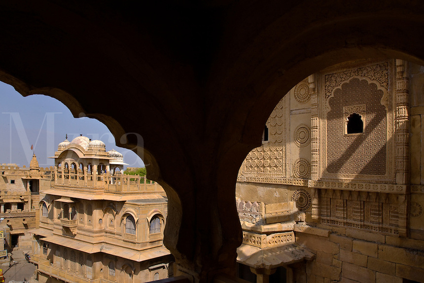Intricately carved sandstone screens decorate the exterior of the MAHARAJA'S PALACE located inside JAISALMER FORT - RAJASTHAN, INDIA