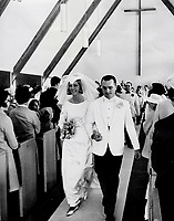 Maple Leaf hockey player Ron Ellis with his bride; the former Janis Greenlaw; leave Rexdale United Church; after their wedding Saturday. The couple have been friends since they were nine. They are honeymooning in the Bahamas.
