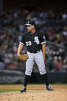 Chicago White Sox relief pitcher Zach Duke (33) looks to his catcher for the sign against the Charlotte Knights at BB&T Ballpark on April 3, 2015 in Charlotte, North Carolina.  The Knights defeated the White Sox 10-2.  (Brian Westerholt/Four Seam Images)