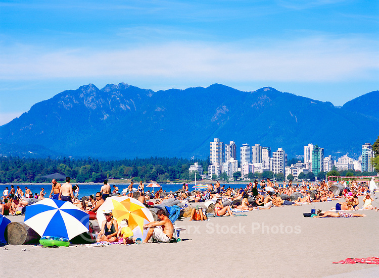 Crowded Kitsilano Beach in Summer, Vancouver, BC, British Columbia, Canada - Stanley Park, West End, and North Shore Mountains (Coast Mountains) beyond