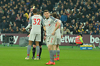 Joel Matip of Liverpool Receives a Yellow Card during West Ham United vs Liverpool, Premier League Football at The London Stadium on 4th February 2019