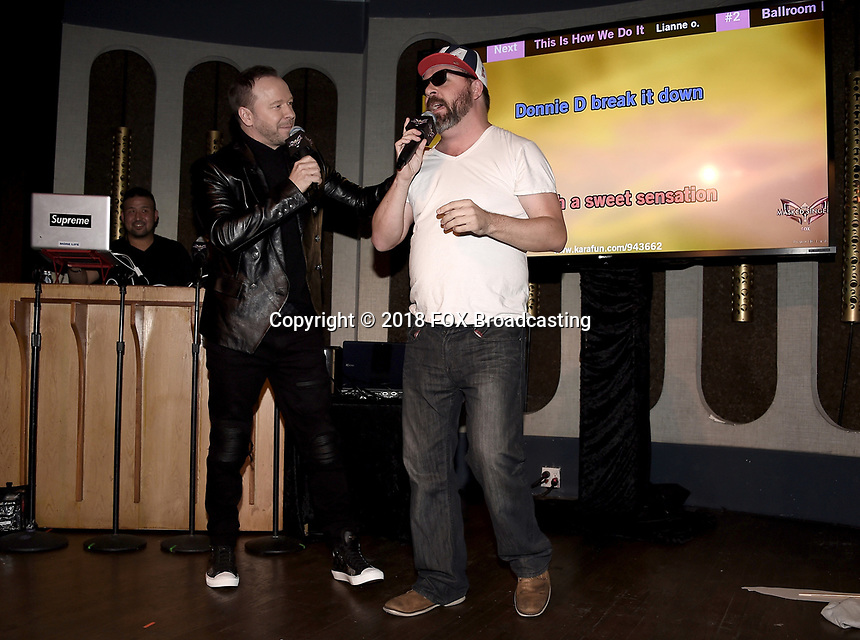 WEST HOLLYWOOD, CA - DECEMBER 13: Donnie Wahlberg (L) and guest attend the premiere karaoke event for season one of THE MASKED SINGER on Thursday, Dec.13 at The Peppermint Club in West Hollywood, California. (Photo by Scott Kirkland/FOX/PictureGroup)