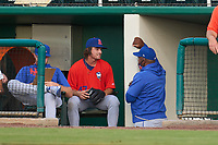 St. Lucie Mets pitcher J.T. Ginn (47) talks with pitching coach Jerome Williams (50) during a game against the Fort Myers Mighty Mussels on June 3, 2021 at Hammond Stadium in Fort Myers, Florida.  (Mike Janes/Four Seam Images)