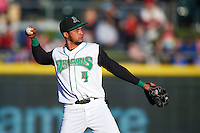 Dayton Dragons second baseman Ronald Bueno (4) warmup throw to first during a game against the Great Lakes Loons on May 21, 2015 at Fifth Third Field in Dayton, Ohio.  Great Lakes defeated Dayton 4-3.  (Mike Janes/Four Seam Images)