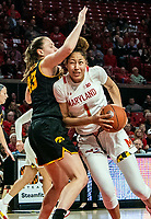 COLLEGE PARK, MD - FEBRUARY 13: Shakira Austin #1 of Maryland pushes past Amanda Ollinger #43 of Iowa during a game between Iowa and Maryland at Xfinity Center on February 13, 2020 in College Park, Maryland.