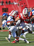 Southern Methodist Mustangs wide receiver DARIUS JOHNSON(3) and Southern Methodist Mustangs wide receiver AUSTIN FULLER (18) tackle Memphis Tigers defensive back BOBBY MCCAIN (21) during the game between the Memphis Tigers and the Southern Methodist Mustangs at the Gerald J. Ford Stadium in Dallas, Texas. SMU defeats Memphis 44 to 13.