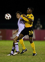 Alejandro Guido (10) of the United States fights for the ball with Romario Williams (7) of Jamaica during the semifinals of the CONCACAF Men's Under 17 Championship at Catherine Hall Stadium in Montego Bay, Jamaica. The United States defeated Jamaica, 2-0.