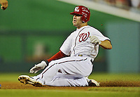 20 September 2012: Washington Nationals infielder Danny Espinosa slides into third during a game against the Los Angeles Dodgers at Nationals Park in Washington, DC. The Nationals defeated the Dodgers 4-1, clinching a playoff birth: the first time for a Washington franchise since 1933. Mandatory Credit: Ed Wolfstein Photo