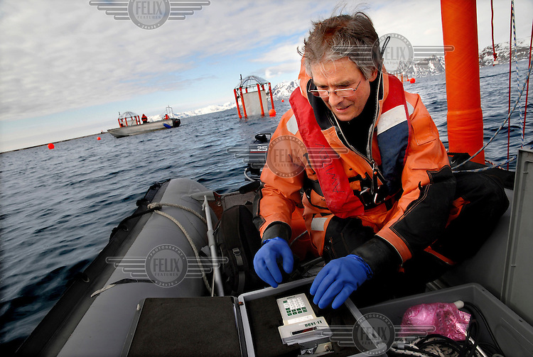 French scientist Jean Pierre Gatusso analyses water samples on his zodiac in the middle of Kongsfjorden on Svalbard archipelago, inside the Arctic Circle. Gatusso works at the science village at Ny-Alesund.
