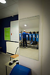 Bishop Auckland 3 West Auckland Town 1, 22/01/2016. Heritage Park, Northern League Division One. The kit man laying out the home team strips before Bishop Auckland host West Auckland Town in a Northern League division one match at Heritage Park. Bishop Auckland were winners of the Amateur Cup 10 times between 1895 and 1957 whilst their opponents won the Sir Thomas Lipton Trophy, regarded as the first world club tournament, in 1909 and 1911.  Bishop Auckland won this fixture 3-1, watched by a crowd of 422 at the ground they moved into in 2010. Photo by Colin McPherson.