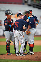 Bowing Green Hot Rods pitching coach Bill Moloney (37) talks with pitcher Fernando Baez (28) as catcher David Rodriguez (7) and third baseman Kevin Padlo (11) listen in during a game against the Quad Cities River Bandits on July 24, 2016 at Modern Woodmen Park in Davenport, Iowa.  Quad Cities defeated Bowling Green 6-5.  (Mike Janes/Four Seam Images)