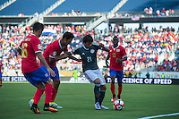 Orlando, Florida - Saturday, June 04, 2016: Paraguayan forward Oscar Romero (21) protects the ball from two Costa Rican defenders during a Group A Copa America Centenario match between Costa Rica and Paraguay at Camping World Stadium.