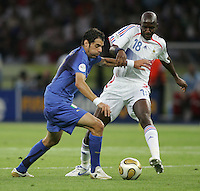 Italian midfielder (20) Simone Perrotta fights for the ball with French midfielder (18) Alou Diarra.  Italy defeated France on penalty kicks after leaving the score tied, 1-1, in regulation time in the FIFA World Cup final match at Olympic Stadium in Berlin, Germany, July 9, 2006.