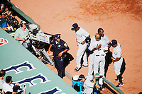BOSTON, MASS. - SEPT. 28, 2014: Members of the Yankees hug Derek Jeter after he batted a run in and left the game at his last at bat as New York Yankees and Boston Red Sox play at Fenway Park. The game is last game of Derek Jeter's career. M. Scott Brauer for The New York Times