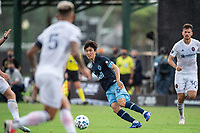LAKE BUENA VISTA, FL - JULY 23: Hwang In-Beom #6 of Vancouver Whitecaps FC kicks the ball during a game between Chicago Fire and Vancouver Whitecaps at Wide World of Sports on July 23, 2020 in Lake Buena Vista, Florida.