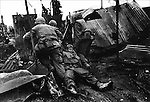 U.S. Marines drag a wounded comrade, Têt offensive, Battle of Hué, Vietnam, February 1968