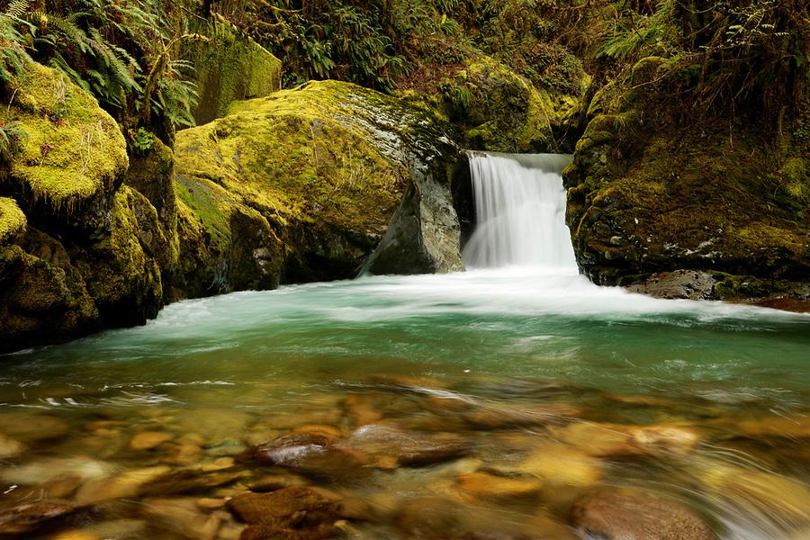Big Creek falling over Teepee Falls and through mossy boulders, Darrington, Skagit County, Washington, USA