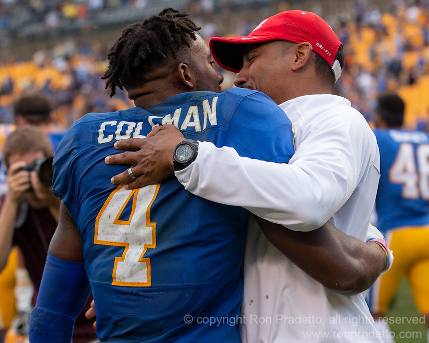Pitt defensive back Therran Coleman gets congratulations from a coach after intercepting a pass in overtime to win the game. The Pitt Panthers defeated the Syracuse Orange 44-37 in overtime at Heinz Field in Pittsburgh, Pennsylvania on October 6, 2018.