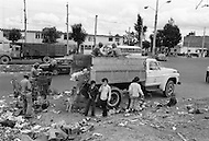 Children who make their living collecting garbage in Bogota, Colombia - Child labor as seen around the world between 1979 and 1980 – Photographer Jean Pierre Laffont, touched by the suffering of child workers, chronicled their plight in 12 countries over the course of one year.  Laffont was awarded The World Press Award and Madeline Ross Award among many others for his work.