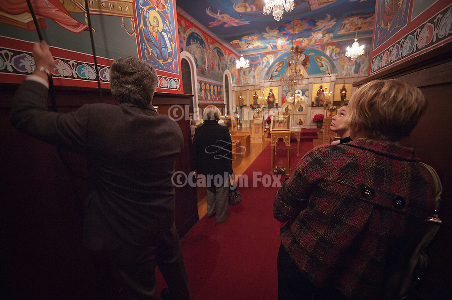Ringing the bell in celebration at the Christmas Eve Vigil Service, St. Sava Serbian Orthodox Church, Jackson, Calif.