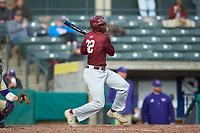 Tim Johnson (32) of the Saint Joseph's Hawks follows through on his swing against the Western Carolina Catamounts at TicketReturn.com Field at Pelicans Ballpark on February 23, 2020 in Myrtle Beach, South Carolina. The Hawks defeated the Catamounts 9-2. (Brian Westerholt/Four Seam Images)
