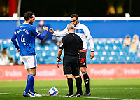 31st October 2020; The Kiyan Prince Foundation Stadium, London, England; English Football League Championship Football, Queen Park Rangers versus Cardiff City; Sean Morrison of Cardiff City and Geoff Cameron of QPR starting game with respect