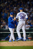 Chicago Cubs manager Joe Maddon (70) takes the ball from pitcher Mike Montgomery (38) for a pitching change in the eighth inning during Game 3 of the Major League Baseball World Series against the Cleveland Indians on October 28, 2016 at Wrigley Field in Chicago, Illinois.  (Mike Janes/Four Seam Images)