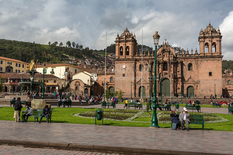 Peru, Cusco.  The Cathedral, 16th. century, Plaza de Armas.  Fountain with Inca King Pachacutec on left.