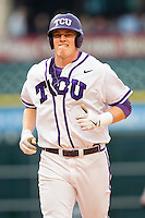 Kevin Cron #00 of the Texas Christian Horned Frogs jogs back to the dugout during the game against the Sam Houston State Bearkats at Minute Maid Park on February 28, 2014 in Houston, Texas.  The Bearkats defeated the Horned Frogs 9-4.  (Brian Westerholt/Four Seam Images)