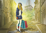 Woman walking with shopping bags in street with Eiffel Tower in the background, Paris, France