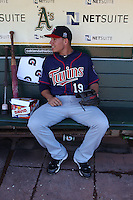 OAKLAND, CA - JUNE 5:  Danny Valencia #19 of the Minnesota Twins gets ready in the dugout before the game against the Oakland Athletics at the Oakland-Alameda County Coliseum on June 5, 2010 in Oakland, California. Photo by Brad Mangin