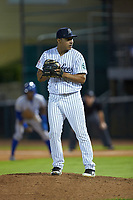 Pulaski Yankees relief pitcher Jhonatan Munoz (43) looks to his catcher for the sign against the Burlington Royals at Calfee Park on August 31, 2019 in Pulaski, Virginia. The Yankees defeated the Royals 6-0. (Brian Westerholt/Four Seam Images)