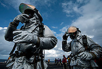 120420-N-DR144-173 INDIAN OCEAN (April 20, 2012) Sailors assigned to the Air Department's Crash and Salvage Division respond to a simulated fuel station fire during aircraft firefighting drills on the flight deck aboard the Nimitz-class aircraft carrier USS Carl Vinson (CVN 70). Carl Vinson and Carrier Air Wing (CVW) 17 are deployed to the U.S. 7th Fleet area of operations. (U.S. Navy photo by Mass Communication Specialist 2nd Class James R. Evans/Released).