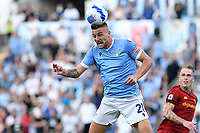 26th September 2021;  Stadio Olimpico, Rome, Italy; Italian Serie A football, SS Lazio versus AS Roma; Sergej Milinkovic Savic of SS Lazio leaps to score his goal for 1-0 in the 10th minute