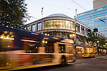 A Trimet bus passing in front of Pioneer Place in Portland, OR.