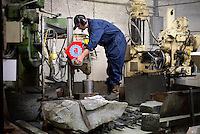 A curling stone, made from Ailsa Craig granite, being cut at Kay's in Mauchline, Faslane. The company uses the same rock to make the stones that will be used at the Sochi Olympic Games.