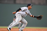 Third baseman Oswaldo Cabrera (9) of the Charleston RiverDogs plays defense in a game against the Greenville Drive on Thursday, July 27, 2017, at Fluor Field at the West End in Greenville, South Carolina. Charleston won, 5-2. (Tom Priddy/Four Seam Images)