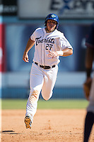 Roberto Ramos (27) of the Asheville Tourists hustles towards third base against the Rome Braves at McCormick Field on July 26, 2015 in Asheville, North Carolina.  The Tourists defeated the Braves 16-4.  (Brian Westerholt/Four Seam Images)