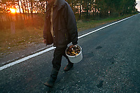 UKRAINE, Chernobyl, 2010/10/8<br /> MUSHROOM PICKING - Sascha goes mushroom picking in to the Forbidden Zone. He knows how to get through the roadblocks and barbed wire. He insists that best mushrooms grow inside the Zone, Chernobyl, October 8, 2010. <br /> © Vaclav Vasku/EST&OST