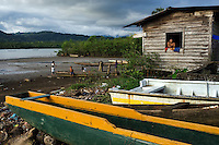 House by the river in afternoon light. Jaque, Panama.