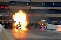 Jul. 1, 2012; Joliet, IL, USA: NHRA top fuel dragster driver Tony Schumacher (left) has an explosion and fire alongside T.J. Zizzo during the Route 66 Nationals at Route 66 Raceway. Mandatory Credit: Mark J. Rebilas-