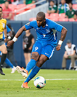 DENVER, CO - JUNE 19: Kevin Fortune #9 scores a goal during a game between Martinique and Cuba at Broncos Stadium on June 19, 2019 in Denver, Colorado.