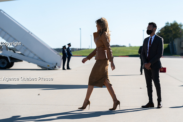First Lady Melania Trump Travels to NC<br /> <br /> First Lady Melania Trump walks across the tarmac at Joint Base Andrews, Md. Monday, Nov. 2, 2020, before boarding Bright Star to begin her trip to North Carolina. (Official White House Photo by Andrea Hanks)